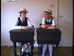 Pretty school girls pull up their gymslips for a hard spanking over the prefects knee