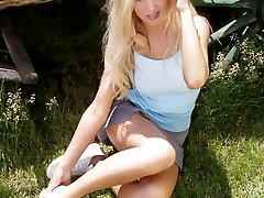 Kim gets hot on the farm and shows her long legs