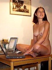 naked girlfriends at a computer