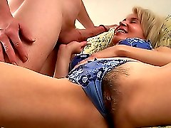 Nasty blond mom spreads her hairy muff and gets a stiff cock digging her deep