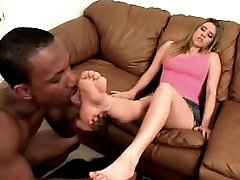 Ebony stud foot-licking blonde bitch and masturbating with her pink-toed feet.