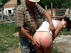 Outdoor caning for a pretty young brunette on her round ass