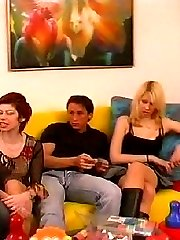 Swinging couples swapping their partners in a swinger club