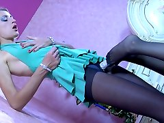 Two babes in black control top tights enjoy the pleasures of lez foot sex