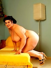 Massive BBW model spreading her fat covered pussy wide to take hard cock hitting in her slit
