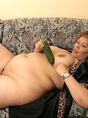 Big horny woman with big nipples plays with cucumber