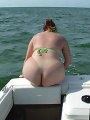 Chubby nudist women in a boats