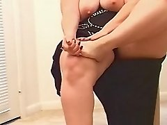 Blonde fatty undressing while getting horny with her foot