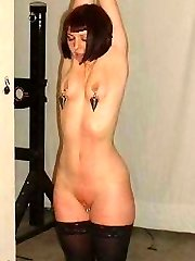 I really enjoy placing clamps on my slaves pussy during her breast bondage session.