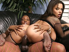 Two horny ebony babes playing with a strap-on!