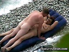 A nudist couple enjoy someslow tender lovemaking right near the ocean