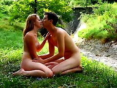 In the middle of the woods, this cute but very horny teen doesnt hesitate to strip out of her...