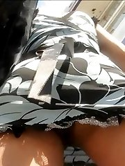 The enticing outdoor upskirt of girl in short tight dress was spied on hunters camera