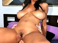 Light skinned black babe slides a dick between her massive tits