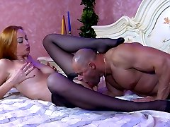 Hot redhead rewards her guy with nylon footjob and foot sex for toe sucking