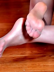 Upskirt teaser dildo toys thru crotchless tights exposing her gorgeous feet