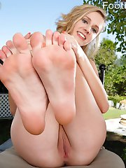 Rachel James has been working out, but her boyfriend wants her toes. He loves to lick her feet after a workout, and gets really turned on. She strokes his cock with her feet, and makes her pussy wet and ready to fuck. She begs him to fuck her and cum all over her feet.