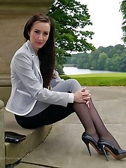 Gorgeous black-haired Sophia gets out the office to walk and taunt outdoors in nylon tights and high stiletto heels