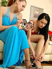 Lusty lesbian gal in sheer pantyhose savouring every sole touch on her pussy