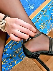 Lusty gal in stiletto heel shoes eagerly spreading her legs in black tights