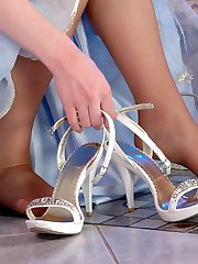 Raunchy bride in reinforced toes pantyhose going for steamy footsy games