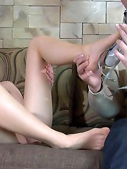 Cutie teases a boy with her nyloned feet in high high-heeled shoes before a red-hot fuck