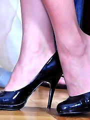 Leggy girl gets her nylon clad feet worshipped and licked for a hot footjob