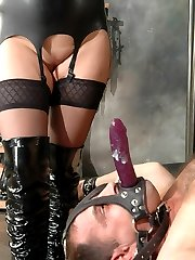 Chubby mistress fucks cuffed slaves ass with a glass toy and rides his facial strapon