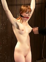 Welcome Marie McCray to Device Bondage. This tiny redhead looks so sweet, so innocent... we are...