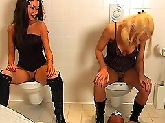 Toilet victim training with Roxy in boots