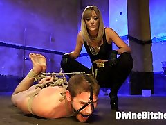 Mona Wales undresses slave, Alex Adams, of any male pride he had continuous in his body. She uses tight hogtied bondage, humiliation and an electrified fuckpole stroker! He also can't control himself around her cold black leather shoes and sweaty feet. Once she slides her meaty black rubber fuck-stick deep inside him he can't help but blow his humungous load two times over and is made to munch it!