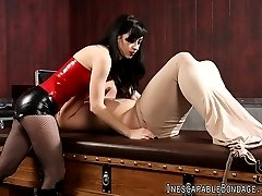Miss Mina treats her slave to an encasement tube which forms a cocoon like casing around his...