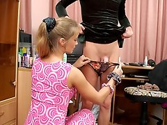 Nasty babe with strap-on working sissy guys asshole to the best advantage