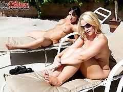 Two tot babes laying out by the pool turn naughty