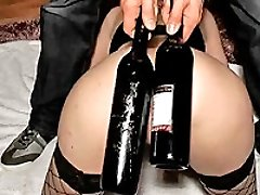 Young amateur whore ass fucked with a huge wine bottle