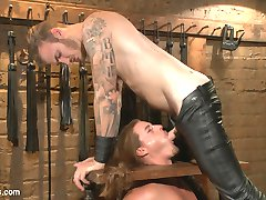 Kip Johnson struggles against the belts strapping him down to an iron cage, not knowing what...