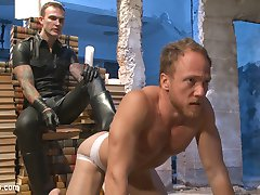 Facing accusations of perving on his football players, Coach Chris Burke receives a stern warning from his boss, Christian Wilde. However, Chris feels more horny than worried about his job. He drifts into a fantasy of punishment beyond administrative reprimand, into a dark world of chains and leather. He crawls to Mr. Wilde, seated on a throne of books and accepts his submission, licking Mr. Wilde's boots and admitting his perversions. In response, Mr. Wilde facefucks and crops the coach before leading him to a rope suspension. Mr. Wilde works a raging boner from Chris before hoisting his bound body high above the ground and covering it in clothespins. Chris swings in the darkness as Mr. Wilde cleans the pins off with a vicious flogging. Mr. Wilde brings Chris back to earth for a brief moment to encage him, but swiftly returns the coach to the air, legs jutting out of the cage, vulnerable to an extended bastinado. Chris receives a deep dicking through the cage as Mr. Wilde hangs from it. With his boss ready to cum, Chris is led on his knees back to the throne and gratefully takes a hot load on his face. In return, Mr. Wilde commands him to jizz on his boots and then lick them clean. Hungry for more cum, Chris dutifully complies.