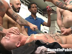 The boys aren't finished with the arrogant Tyler Rush. Now that Rocco Steel -- the laundromat's owner -- joined the gangbang, these dudes have the whole day to teach Tyler a lesson in manners. Wearing a full rope harness on top of a folding table, Tyler takes huge cocks in his mouth and faces a dual torment of relentless edging mixed with a painful paddling. Hot wax covers his sensitive nipples, abs and thighs as the dudes edge his cock over and over. Smothered all over by strangers' hands, Tyler finally lets out a hot load before being made to eat it all. Just as Tyler sighs in relief, Rocco delivers a rough apple polishing. The lesson ain't over yet. The guys run a train on Tyler's ass as his head is stuck in a dryer. They peel Tyler out from the dryer to give him electric shocks and face full of cum. After taking five generous loads to his bitchy face, the dudes lock Tyler away in the dryer to think about what he's done to deserve.