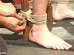 With Christian Wilde as a model sub, Van Darkholme shares his expertise in bondage and edging in front of a live audience. He walks through practical rope work for chairs and beds, binding Christian and with the help of Jessie Colter, working a throbbing erection from the horny stud. Christian reveals to the crowd that he hasn't cum in three days as he moans and squirms in his ropes with each edge. Van then moves to a live Kinbaku demonstration, sensually binding Christian in a suspension. With Jessie teasing Christian's cock along the way, Van guides Christian through different positions and suspensions. After an aerial edge with Van hanging from Christian's swinging body, Van finally decides to allow Christian to cum. With three days of cum built up, Christian busts a huge load to the approval of the crowd.