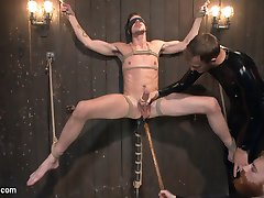 Jack Hunter arrives at the Armory on a brisk autumn day for an audition and photo shoot with KinkMen. Liking what they see through the lens, Sebastian and Christian start playing with Jack. He has his lean body bound in tight ropes as his erection tries to fight its way out of his briefs. Sebastian presses his hitachis against Jack's giant cock, bringing the stud to the edge of an orgasm before taking the toys away. Christian pulls Jack onto a platform box and admires the hard dick standing at full attention. After a round of edging, Jack and Christian return to the green room for a break. Jack starts feeling a little funny after the bondage. Next thing he knows, he's bound to the wall of a dungeon as Christian and Sebastian work their hands all over his body. As he moans and grinds against his bondage, Jack takes a dildo deep inside his hole. Sebastian edges Jack with a hollowed out pumpkin in the spirit of the season. With his huge cock impaling the entire pumpkin, Jack nearly blows it as the vibrating sheath fits over his cock head. Finally deciding to let the stud cum, Christian milks a hot load from Jack while Sebastian holds a vibrator deep within his hole. Fresh from cumming, the torment resumes as Sebastian jacks the sensitive cock once more with the pumpkin.