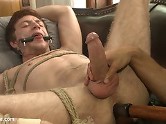 Logan Taylor feels a little nervous about his first time with KinkMen, but his anxieties turn to...