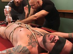 It's a dream come true for Dolf Dietrich: Today, he'll spend a session with Men on Edge. Sebastian and Jessie get to quick work on the stud, fitting his chisled body with ropes on a pool table. All the rope over his muscles has Dolf's throbbing dick ready to launch out of his boxers. Dolf loves having his nipples played with, so Sebastian teases and torments them with a hitachi while Jessie sucks him off. They suspend the stud above the ground and fuck his ass with a dildo. Dolf is just too eager to cum-- grunting, begging and then shouting for orgasm as he swings in the air. They take Dolf back to the billiards room and strap him down to the pool table for repeated edges with the fleshjack and vibrating sheath. As the day comes to end, they finally let Dolf's cock explode and douse his abs in hot cum. Dolf gets a generous taste of his own seed before Jessie concludes the day with a rough apple polishing.