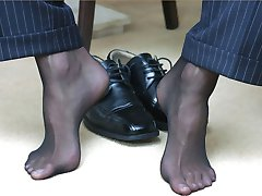 Sometimes office guy Marcello wears some sexy nylon pantyhose under his suit trousers
