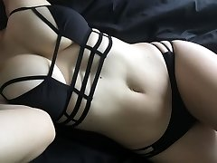 Big-tittied chick shows fine ass and bumpers