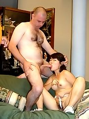 Cock greedy Asian slurping a fat cock and dishes out her hairy pussy in front of the camera