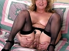 Busty mature poser shows her thick bushed cunt