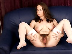 Ultra bushy babe gets her hairy snatch dug out!