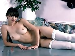Dark-haired stockings chick showing off her smooth ass and hairy cunt
