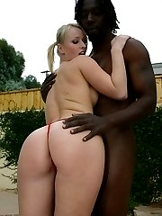 Sexy blonde strokes a fat black dick by pool