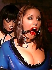 Mistress Brianna dressing her sexy slave in s skin-tight latex suit and stretching her mouth